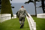 US Soldier pondering in American Cemetery Coleville Sur Mer
